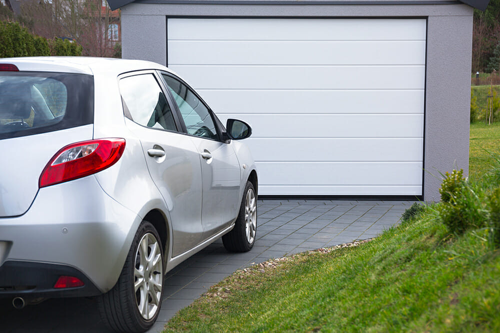 Car parked on driveway infront of garage