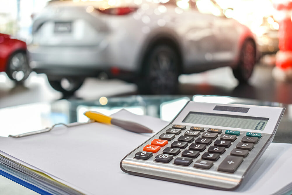 Calculator with car in background