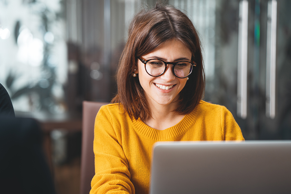 Business women with glasses using laptop