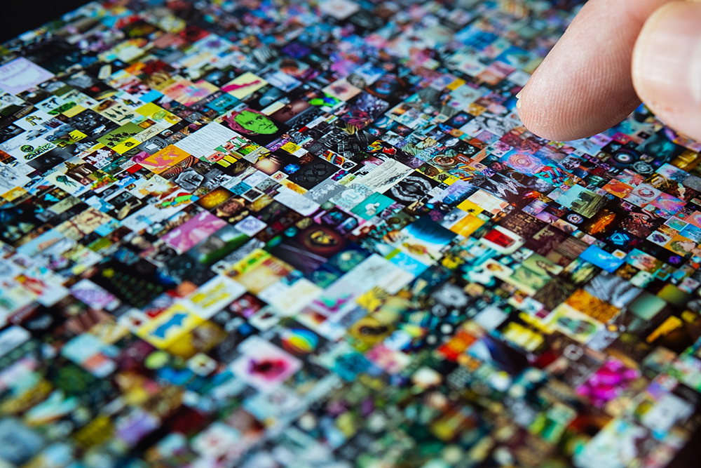 """tablet screen with Beeple pattern """" EVERYDAYS: THE FIRST 5000 DAYS"""""""