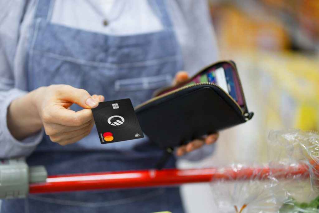 Black Curve Card in hand with wallet