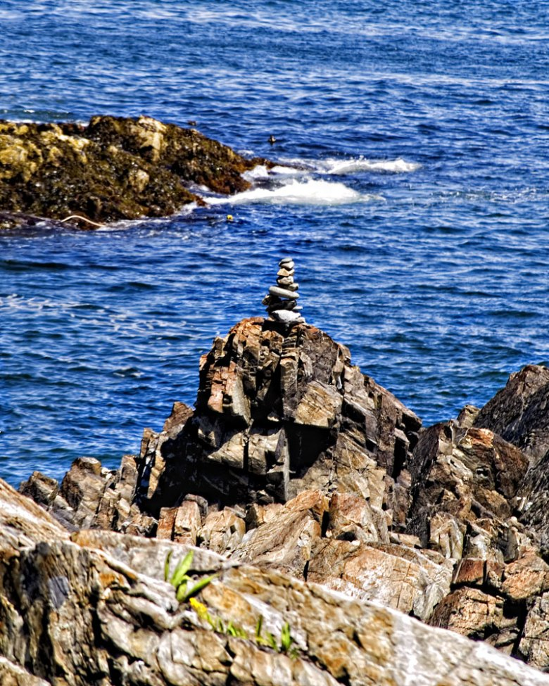Rocky seashore with cairns