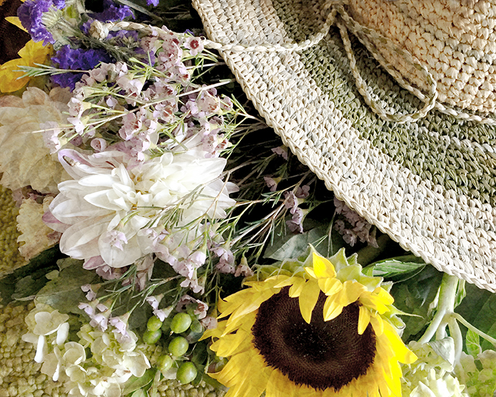 Straw hat and flowers