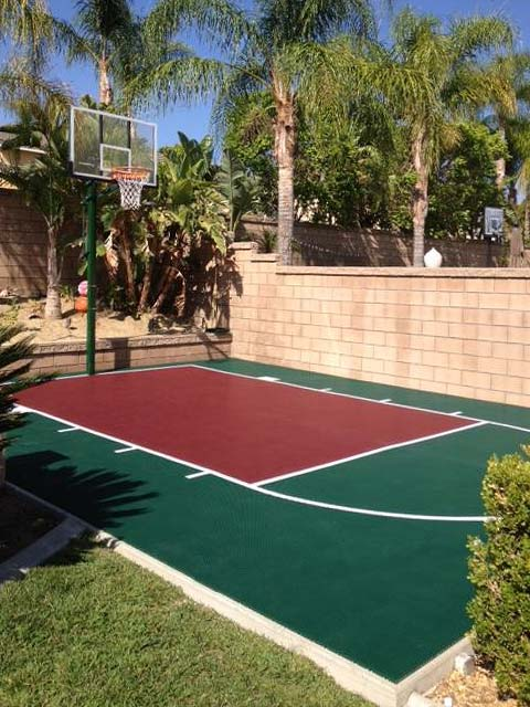 A small basketball court in a backyard