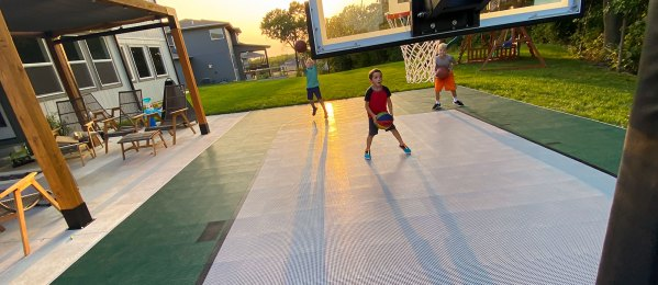 Kids playing basketball on their DunkStar Court
