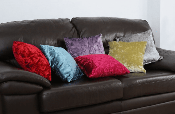 crushed velvet cushions on sofa