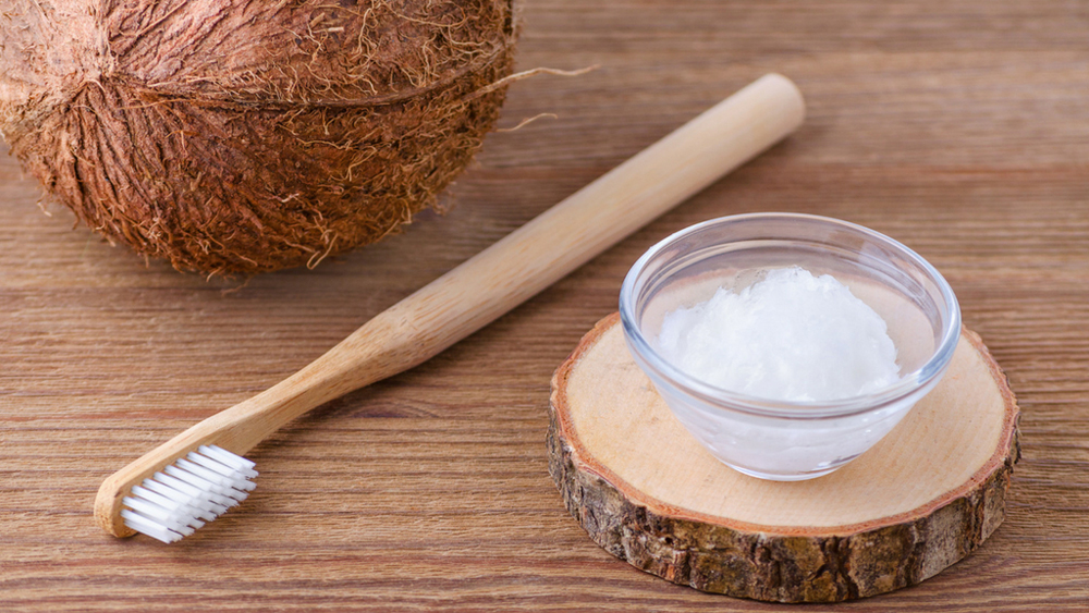 coconut oil pulling white teeth