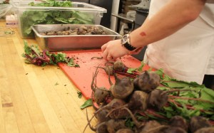 Photo by Aaron Warnick | Photo Editor. A Parkhurst employee chops up radishes in preparation for a catering event on Wednesday. Parkhurst Dining recently lowered the cost of catering services.