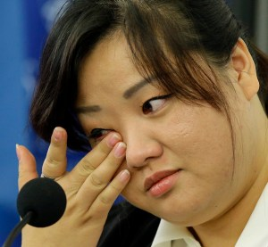 AP Photo. Jin hye Jo wipes a tear on Oct. 30 as she testifies during a hearing of the UN- mandated Commission of Inquiry about the human rights situation in North Korea.