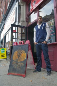 (Zach Brendza / The Duquesne Duke) Spencer Rubeck stands in front of his shop, Innovative Vapors.