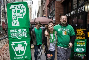 Photo by Claire Murray | Photo Editor. Parade goers walk Downtown on Saturday to celebrate St. Patrick's Day. Despite wet weather, revelers crowded the parade route, Market Square and South Side. Duquesne and Pittsburgh police increased their patrol numbers to reduce drunken antics.