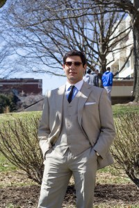 (Fred Blauth / Editor-in-Chief) Sophomore international relations major Nick Santini displays a beige suit, complemented by a pop of color from his blue shirt. A pair of vintage-style shades complete the look.