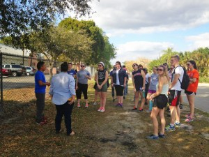 Courtesy Photo. Duquesne students receive a walking tour of farm workers' housing in Immokalee, Florida over spring break. The service trip has been held since 1988.