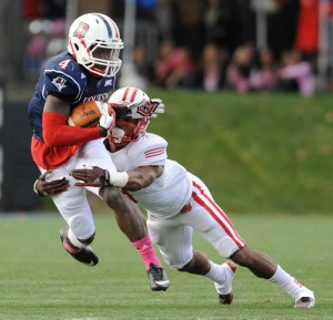 Courtesy Photo. Duquesne safety Chris Johnson, who died Feb. 27, gets tackled after intercepting a pass in a game against Sacred Heart on Oct. 18, 2014.
