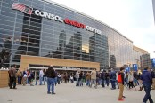 Claire Murray / Photo Editor. Basketball fans mill outside Consol Energy Center March 21 before the Villanova vs. N.C. State NCAA game. Fans brought millions in spending to the city.
