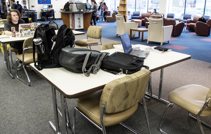 (Claire Murray/Photos Editor) A table in Gumberg Library sits occupied by belongings but unused by students.