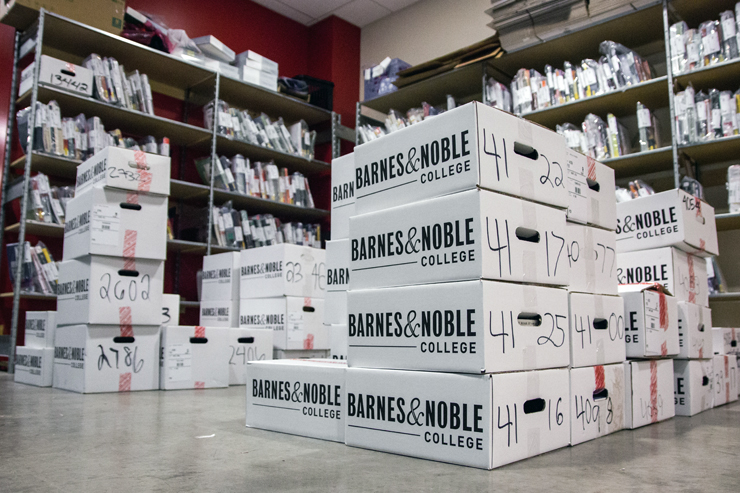 (Claire Murray/Photo Editor) Textbook orders await their student recipients in the basement of the Barnes and Noble bookstore on Forbes Avenue.