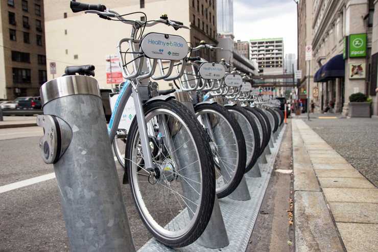 (Claire Murray/Photo Editor) A rack of Healthy Ride bikes on Forbes Avenue awaits riders. Last May saw the launch of Healthy Ride, the city's bike share system, which has 50 stations and 500 bikes across the city.