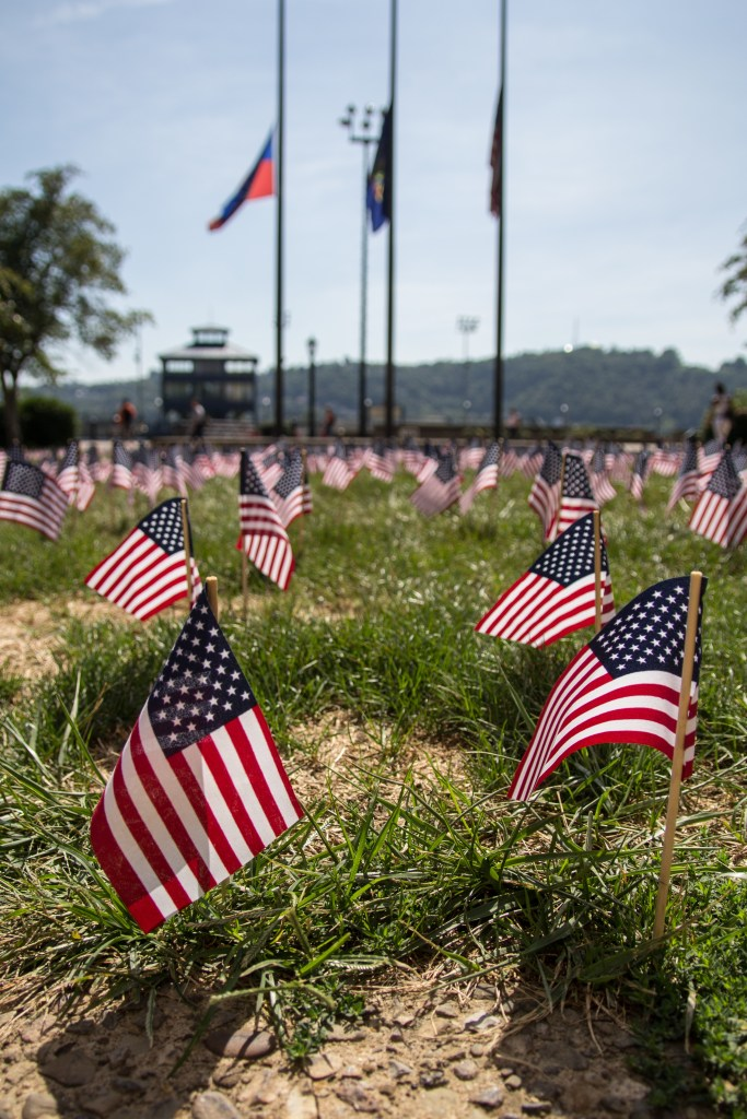 Claire Murray | The Duquesne Duke Hundreds of flags adorn the grass outside College Hall as part of a memorial to the victims of the 9/11 terrorist attack.