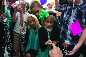 Amber Campbell kneels next to her other daughter, Gracie, 4. Ava Campbell's death after being hit by a drunk driver has sparked concern that people, especially college students, are not choosing responsible methods of transportation when drinking.