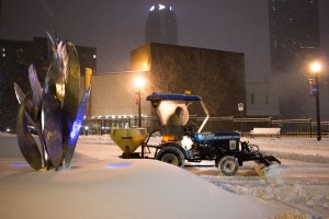 Photo by Seth Culp-Ressler | Features Editor. A utility tractor plows snow at 6:30 a.m. outside the Union during winter storm Jonas on Saturday/