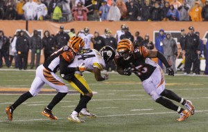 AP Photo - Cincinnati Bengals' Vontaze Burfict (55) runs into Pittsburgh Steelers' Antonio Brown (84) during the second half of an NFL wild-card playoff football game Sunday, Jan. 10, 2016, in Cincinnati. Pittsburgh won 18-16. Burfict was called for a penalty on the play. (AP Photo/John Minchillo)