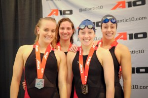 Courtesy of the Atlantic 10 - (Left to right) Former Duquesne swimmer Line Loveberg, sophomore Lexi Santer and seniors Sam Ray and Claire Nobels pose after the 2015 Atlantic 10 swimming championships.