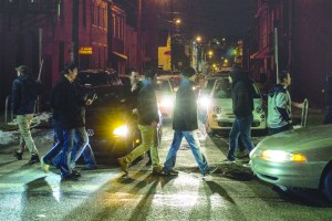 By Aaron Warnick   The Duquesne Duke Revelers cross East Carson Street on a weekend night. Some underage students try to access bars with fake ID's. Students carrying fake ID's who are caught by the police can be arrested and charged with forgery, a felony with a $25,000 fine.