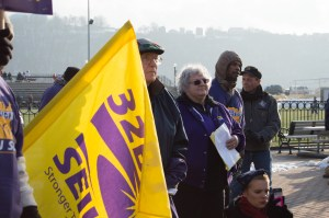 By Joseph Guzy | Photo Editor Father Gary Dorsey and Debbie Byerly listen to a speaker at the food workers rally on a-walk.