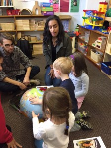 Photo courtesy of Lucia Osa-Melero Duquesne Spanish students show local preschoolers the location of Spanish-speaking countries on a globe as part of a foreign language teaching program.