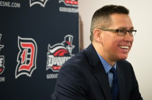 Duquesne Women's Basketball head coach Dan Burt has a laugh with the media after the Dukes' 73-59 victory over the St. Joseph's Hawks. | Joseph Guzy
