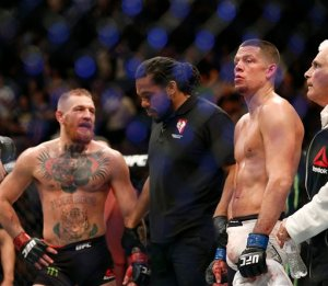AP Photo - Nate Diaz is declared the winner by referee Herb Dean after his second round submission victory over Conor McGregor during their UFC 196 welterweight mixed martial arts match, Saturday, March 5, 2016, in Las Vegas.