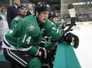 Dallas Stars left wing Jamie Benn (14) watches from the bench during the first period of an NHL hockey game against the Colorado Avalanche, Thursday, April 7, 2016, in Dallas. (AP Photo/Jim Cowsert)
