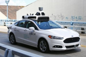 AP Photo A self-driving Ford Fusion hybrid car is test driven, Thursday, Aug. 18, 2016, in Pittsburgh. Uber said that passengers in Pittsburgh will be able to summon rides in self-driving cars with the touch of a smartphone button in the next several weeks.