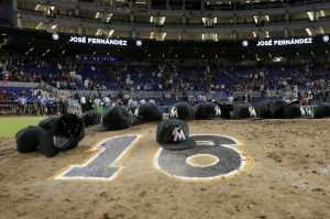 AP Photo | Lynne Sladky Miami Marlins ball caps left by the players sit on the pitching mound with the number 16 in honor of pitcher Jose Fernandez after a baseball game against the New York Mets, Monday, Sept. 26, 2016, in Miami.