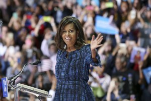 AP Photo. First lady Michelle Obama waves as she speaks at LaSalle University in Philadelphia, Wednesday, Sept. 28, 2016, as she campaigns for presidential candidate Hillary Clinton. Hours later, she flew to Pittsburgh to give a similar speech.
