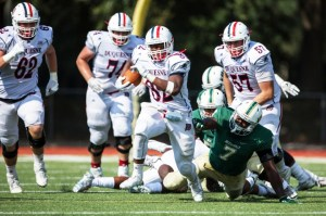 Courtesy of Duquesne Athletics  Freshman running back A.J. Hines slips past the defense of the Jacksonville Dolphins in last Saturday's 54-35 win. His performance guided him to his record-breaking fourth-straight Rookie of the Week honor.