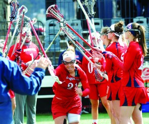Courtesy of Duquesne Athletics | Junior Jill Vacanti runs through a tunnel of her teammates as she is announced as part of the starting lineup on April 8, 2016, against VCU.