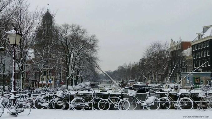 Snow on Singel canal in Amsterdam