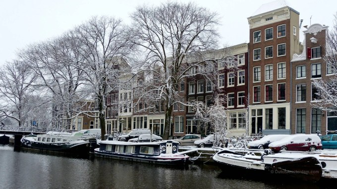 Snow-covered houseboats in Brouwersgracht, Amsterdam