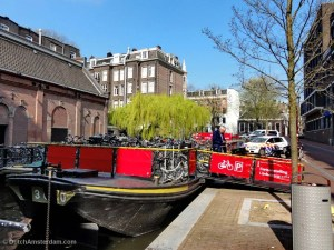 Temporary bike parking facility on a pontoon at De Melkweg