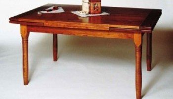 A Mission Dining Table with a Butterfly Leaf
