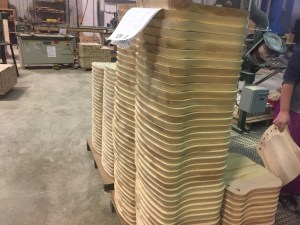 Chair seats stacked in the shop.