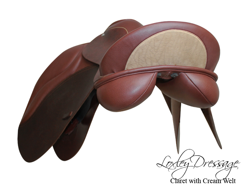 Loxley by Bliss dressage saddle in claret with cream accents