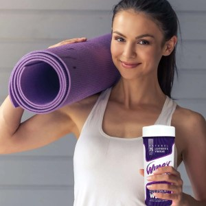 lady holding wipex lavender wipes canister