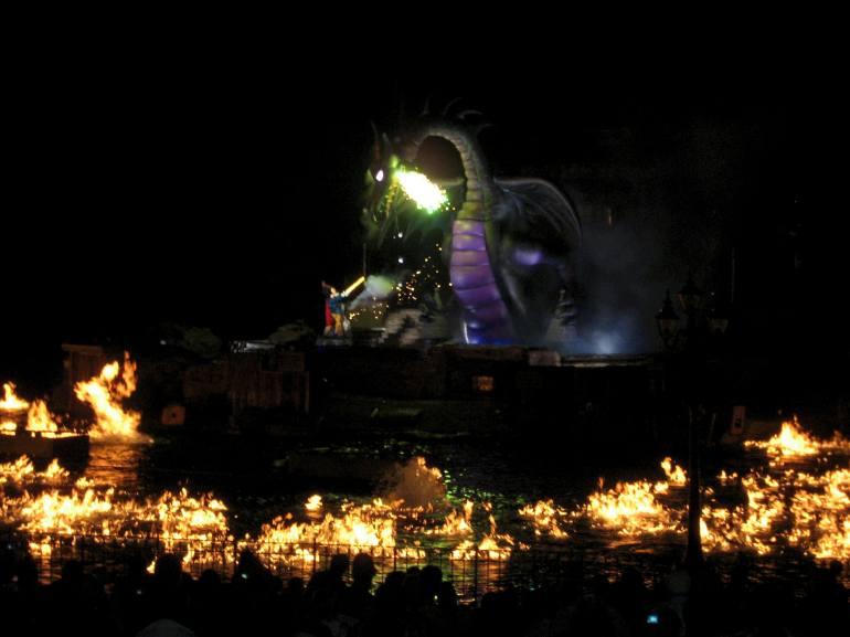 Fantasmic dragon breathing green fire