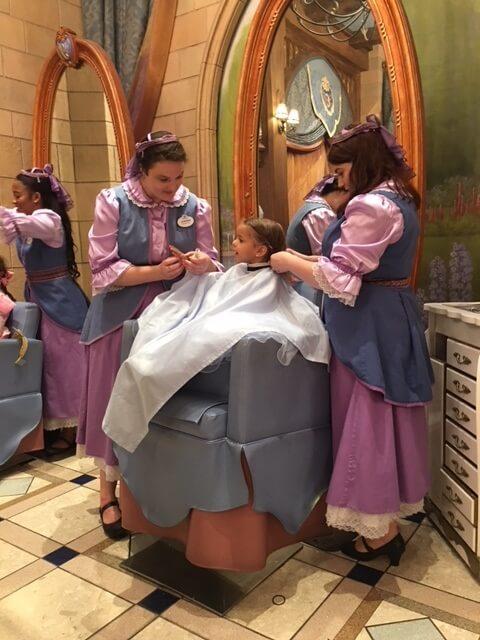 Cast members helping a guest at Bibbidi Bobbidi Boutique at Disney World