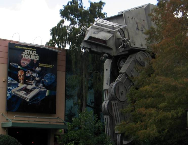 Star Tours sign at Disney in front of an AT-AT walker