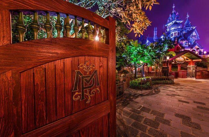 Inside Hong Kong Disneyland at night with Haunted Mansion