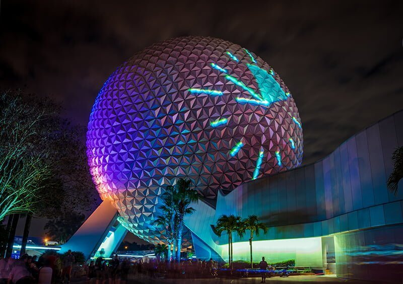 EPCOT Spaceship Earth pictured with clock projected onto exterior at night